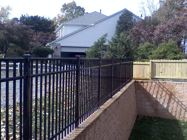 Joining Aluminum Fence And Wood Fence by Phoenix Fence And Deck
