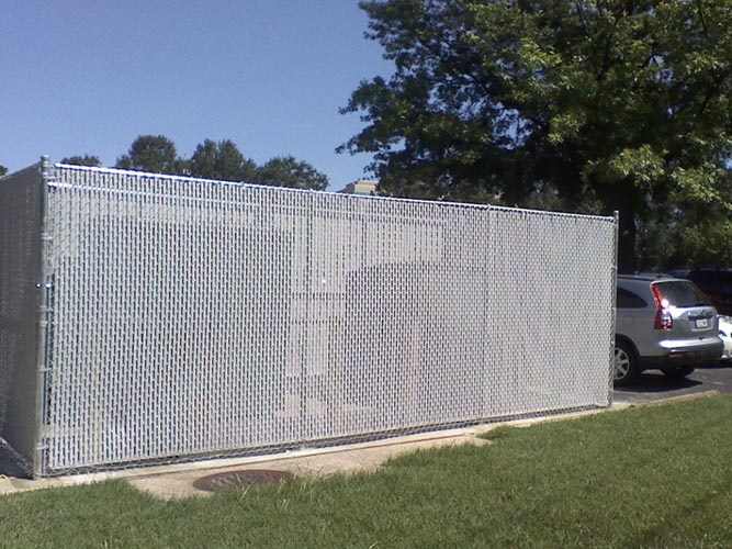 Chain link fence with privacy slats for additional privacy