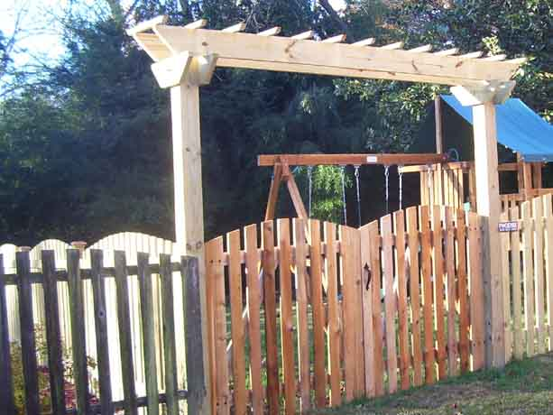 Arched picket fence with arched gate and custom arbor