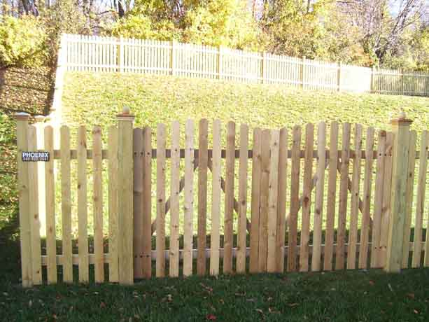 Dog ear picket fence with arched gate