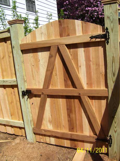 Privacy fence gate with arched top back view
